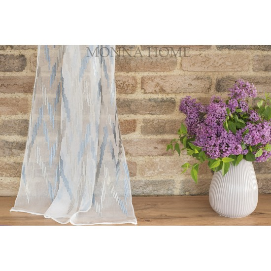 Sheer curtain fabric with figured motifs at the bottom
